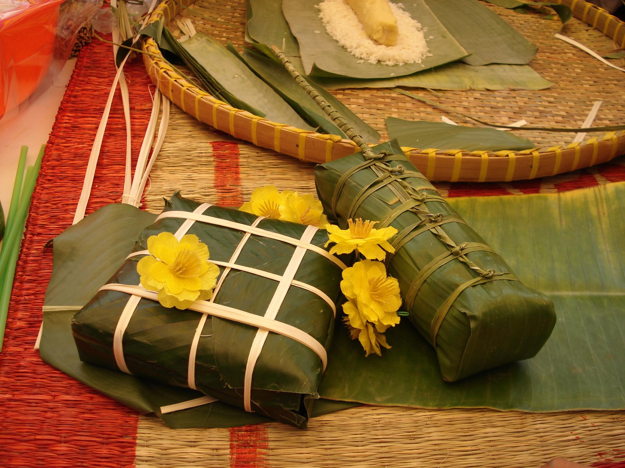 Banh Chung and Banh Tet are glutinous rice cakes wrapped in bamboo ...